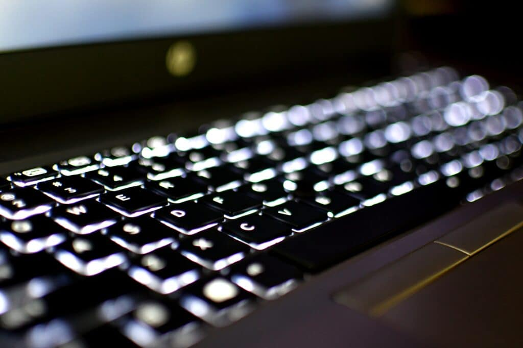 Computer Keyboard with lights and visual effects - concept information data internet